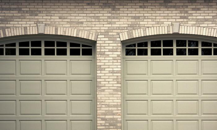 CSS Garage Doors - Atlanta: $99 for a Garage-Door Tune-Up and Roller Replacement from CSS Garage Doors ($208 Value)