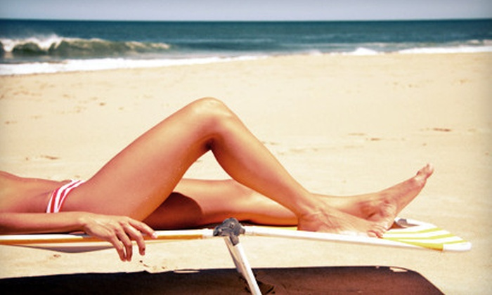 1st & Tan - Quigley Park: Two Mystic Spray Tans or One Month of Unlimited Tanning at 1st & Tan (Up to 68% Off)