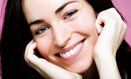 One or Two Zoom! Teeth Whitening Treatments at Smiles NYC (Up to 85% Off)