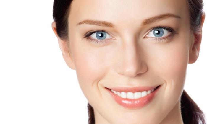 Distinctive Tan - Sammamish: SpaWhite Express or SpaWhite Silver Teeth-Whitening Treatment at Distinctive Tan (Up to 52% Off)