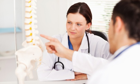 Chiropractor Consult & Adjustment with Optional Therapy Packages at Spine & Sport Rehab Institute (Up to 85% Off)