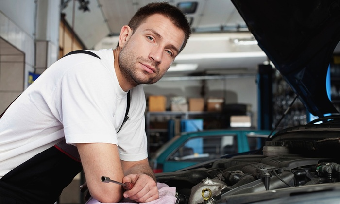Automotive City - Show Place: Oil Change with Filter and Inspection, Four-Wheel Alignment, or Complete Tune-Up at Automotive City (Up to 54% Off)