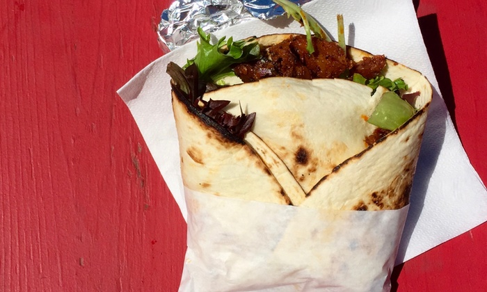 Rhythm n' Wraps - Science Plaza - Harvard University: $12 for Two Groupons, Each Good for $10 Worth of Food and Drink at Rhythm 'n Wraps ($20 Total Value)