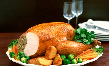 6 or 12 Wine Bottles or Turkey Dinner for 4, 8, or 12 at Tunies Natural Grocery & Vitamin Market (Up to 60% Off)