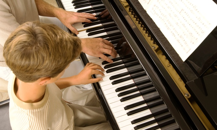 Thompson's Music - St. Petersburg: $50 for $100 Worth of Violin, Piano, Guitar, and Voice Lessons at Thompson's Music