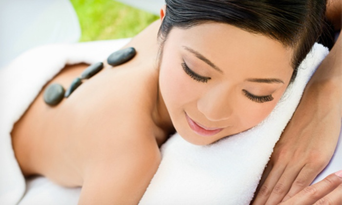 Sage Dragonfly Massage & Bodywork - Greensboro: One or Three Hot-Stone Massages with Gemstone Facial Massages at Sage Dragonfly Massage & Bodywork (Up to 61% Off)