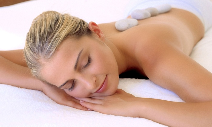 Hot Wraps - Multiple Locations: 60- or 90-Minute Hot-Stone Massage at Hot Wraps (Up to 56% Off)