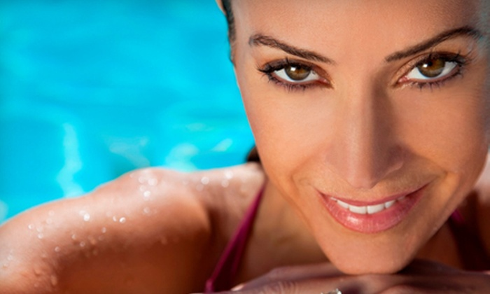 Ella Blue - Elk Grove: One Month of Unlimited Bed Tanning, Three Spray Tans, or Three Spray-Bed Combination Tans at Ella Blue (Up to 62% Off)