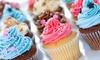 Sweet's Revenge Bakery: Half- or Full-Dozen Regular or Premium Cupcakes, or Two Dozen Cookies at Sweet's Revenge Bakery (Up to 48% Off)