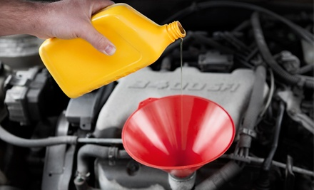 Oil Change with an Optional Tire Rotation and Inspection at Dupont Tire & Auto, Inc. (53% Off)