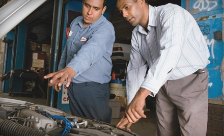 State Safety Inspection with Emissions Test or Oil Change with Tire Rotation at Columbia Auto Repair (Up to 52% Off)