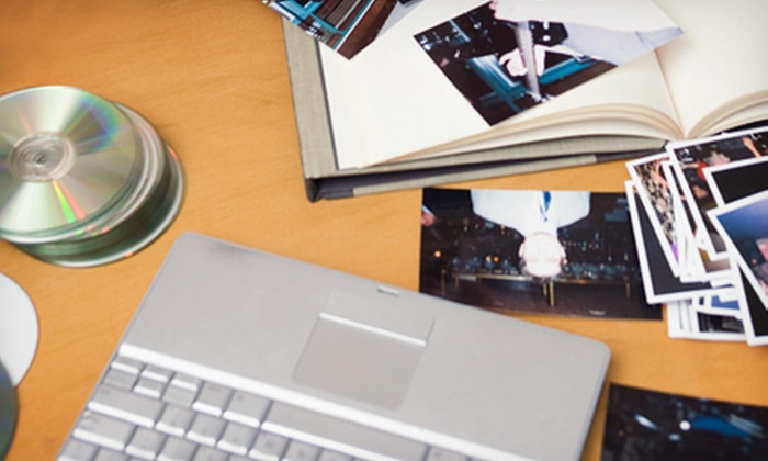 digitizeyourworld.ca: Standard or High-Resolution Photo Scanning with DVD of Up to 600 Photos from digitizeyourworld.ca (Up to 73% Off)