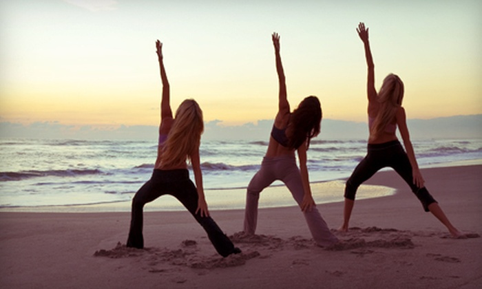 Sacred Movement Yoga - Multiple Locations: 10 or 20 Beach Yoga Classes from Sacred Movement Yoga (Up to 88% Off)