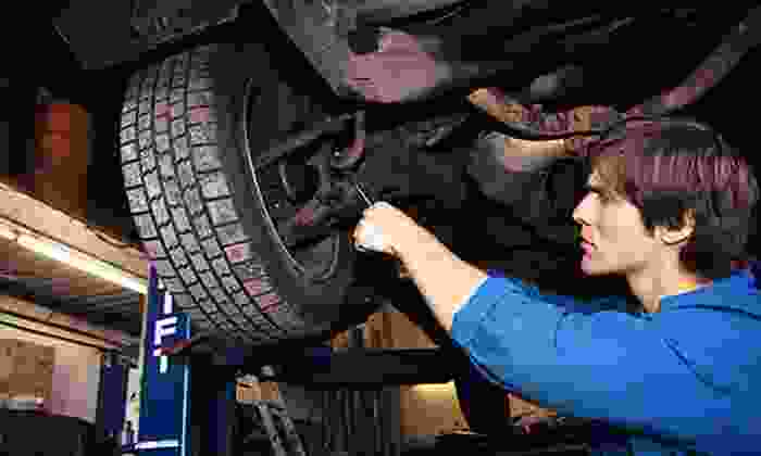 Just Brakes - Multiple Locations: Two- or Four-Wheel Premium Brake Service, Inspection, and Lifetime Warranty at Just Brakes (Up to 55% Off
