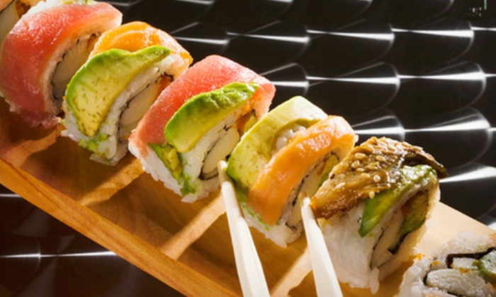 Ahi Revolving Sushi - Gilbert Town Square: Sushi and Drinks for Two or Four at Ahi Revolving Sushi (Half Off). Two Options Available.