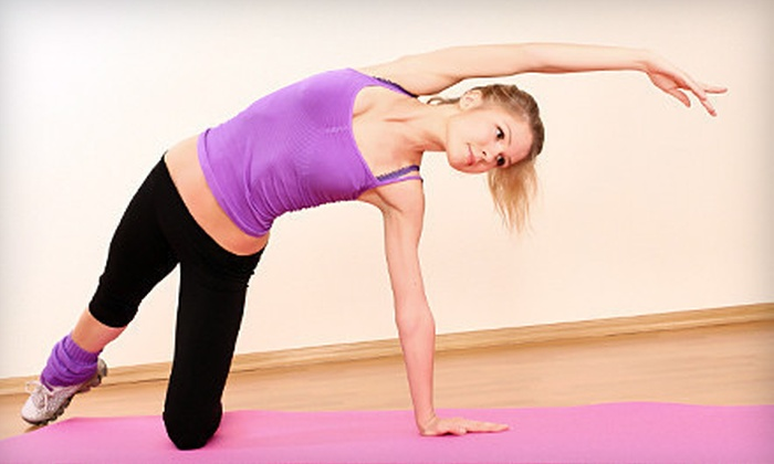 Omaha Power Yoga - West Omaha: $20 for 20 Drop-In Yoga Classes at Omaha Power Yoga (Up to $180 Value)