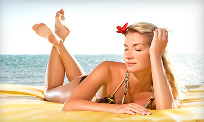 24 Hour Tan - Heritage Club: $25 Worth of Tanning and Red-Light Therapy