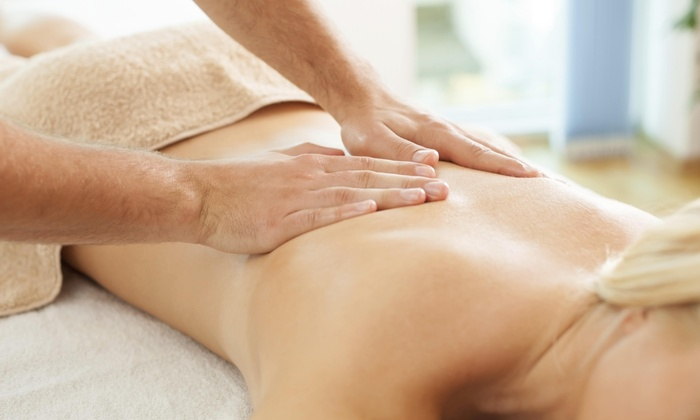 Vibrant Wellness - Saylorville: Deep-Tissue Massage and a Decompression Exam from Vibrant Wellness Massage & Weight Loss Coaching (50% Off)