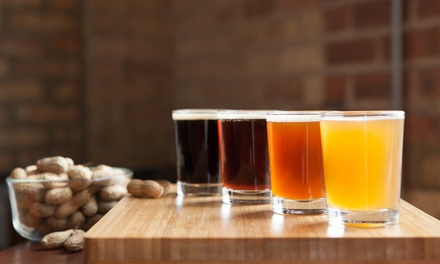 $30 for Beer-Tasting Package for Two with Pint Glasses and Growler at Horny Goat Brew Pub ($65 Value)