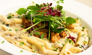 Loving Hut: $13 for $25 Worth of Vegan Cuisine for Two or More at Loving Hut