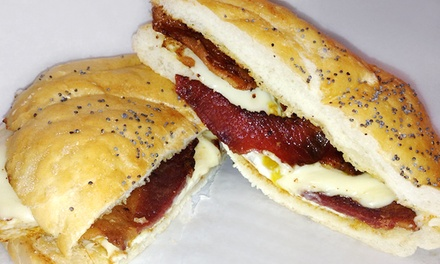 $11 for Four Groupons, Each Good for $5 Worth of Breakfast Food at Junior's NY Deli ($20 Total Value)