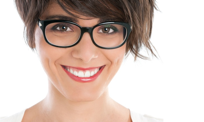 Vision Center - Multiple Locations: Eye Exam and Two Boxes of Contacts or Credit Toward a Complete Pair of Glasses at Vision Center (Up to 84% Off)