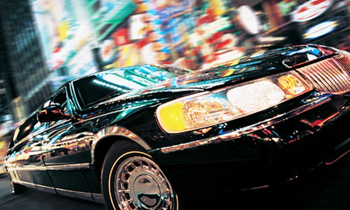 Trinity Limousine Company - West Plaza: 60- or 90-Minute Holiday Plaza Lights Tour with Champagne or Cookies from Trinity Limousine Company (Up to 52% Off)