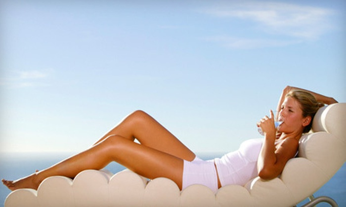 The Club - Goodyear: One or Three Airbrush Spray Tans or One Month of Unlimited Silver Bed Tanning at The Club (Up to 64% Off)