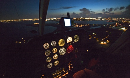 Night Helicopter Tour with Champagne and Photos for One, Two, or Four from HQ Aviation LLC (Up to 56% Off)