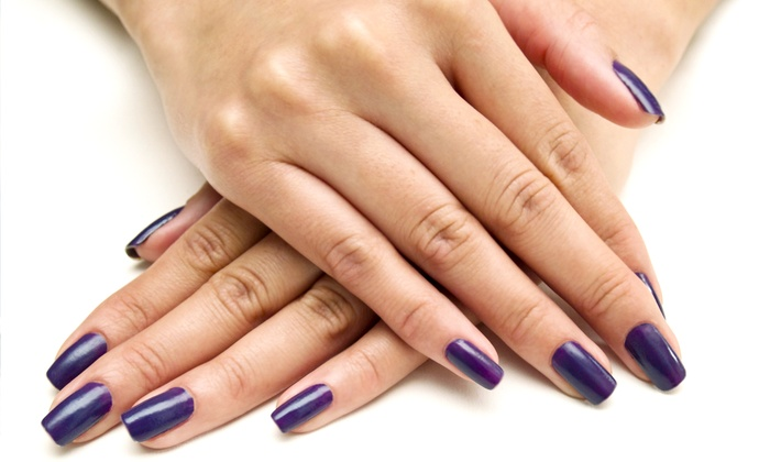 Revo Nails & Spa - Multiple Locations: One or Two Groupons, Each Valid for a Paraffin Manicure with Shellac Polish at Revo Nails & Spa (Up to 51% Off)