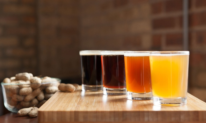 Elliotts Pour House - Baltimore: Beer Flight for Two or Four, or $11 for $20 Worth of Drinks at Elliott's Pour House