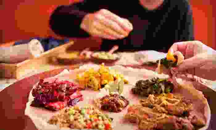 Meda Ethiopian Bar and Restaurant - Atlantic-University: Ethiopian Cuisine for Dinner for Two or Four at Meda Ethiopian Bar and Restaurant (Half Off)