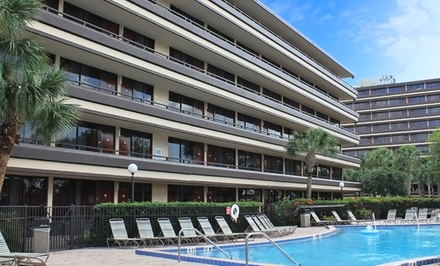 groupon daily deal - Stay at Rosen Inn at Pointe Orlando in Orlando. Dates into December.