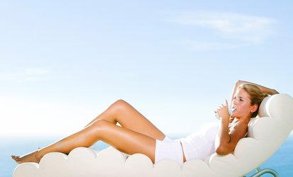 image for One or Three Full-Body Airbrush Tans at Glo Face & Body (Up to 54% Off)