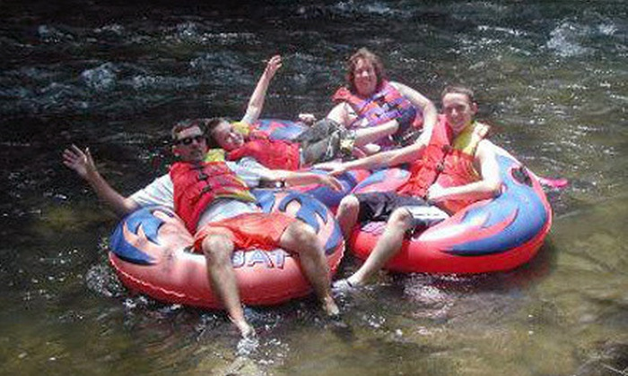 The Smokey Mountain River Romp - Sevierville: Two or Four Individual River-Tubing Rides at The Smokey Mountain River Romp (Up to 54% Off)