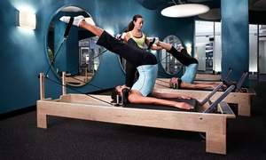 Crunch Fitness: One Reformer Session, Three or Six Group Sessions, or Two Private Sessions at Crunch Fitness (67% Off)