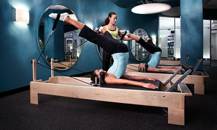 One Reformer Session, Three or Six Group Sessions, or Two Private Sessions at Crunch Fitness (67% Off)