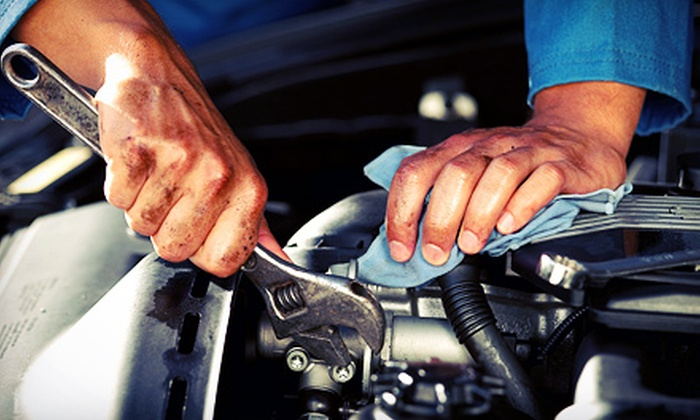 Pro-Automotive & Goodyear Tire - West & North End: $67 for $149 Worth of Auto Maintenance and Repair at Pro Automotive & Tire