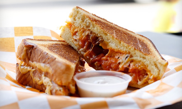 Cheesie's Pub & Grub - Multiple Locations: $18.99 for a Grilled Cheese Meal and Beers for Two at Cheesie's Pub & Grub (Up to $36 Value)