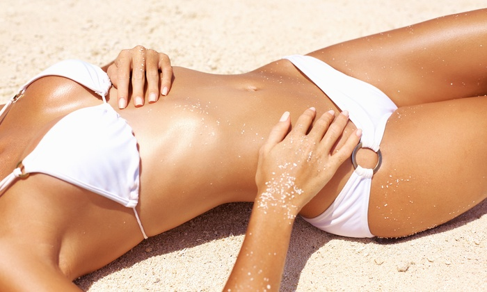 Electric Beach Tans - Hurst: One Spray Tan or One Month of UV Tanning at Electric Beach Tans (Up to 58% Off)