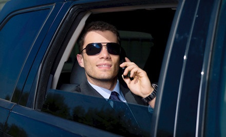 [Roundtrip Airport Transportation in a Sedan or a Van or SUV from Border Limousine Service (Up to 58% Off) Image]