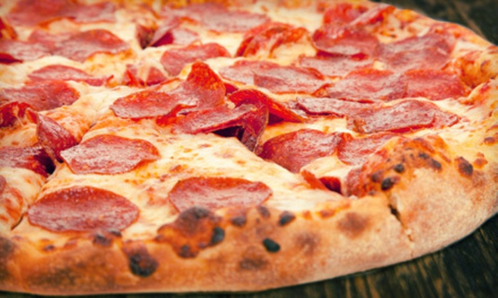 Ciago's - University: $11 for a Pizza Dinner with Salads and Soft Drinks for Two at Ciago's ($22.21 Value)