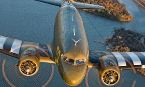 Greatest Generation Aircraft: Holiday-Lights Flight Tour in a Douglas C-47 for One or Two from Greatest Generation Aircraft (Up to 73% Off)