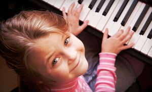 Every Family Needs Music: $35 for Four Group Lessons for Guitar, Piano, or Voice at Every Family Needs Music ($130 Value)