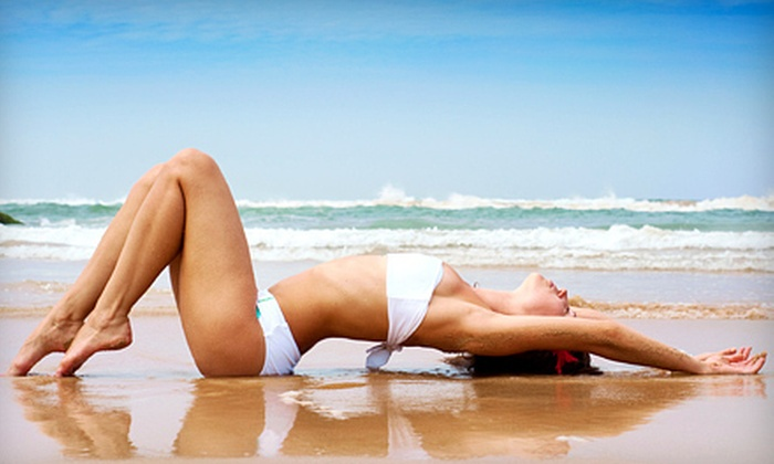 Solar Eclipse Tanning Salon - Multiple Locations: Bed or Spray Tanning or Red-Light Therapy at Solar Eclipse Tanning Salon (Up to 71% Off). Six Options Available.