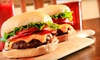 P.M. Restaurant and Lounge - Britannia Youngstown: Burgers and Beers for Two or Large Specialty Pizza with Appetizer and Beers for Four at P.M. Restaurant (Up to 55% Off)