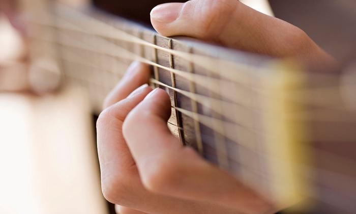 Hum Strum Drum - Multnomah: Four or Eight 30-Minute Guitar Lessons at Hum Strum Drum (Up to 53% Off)