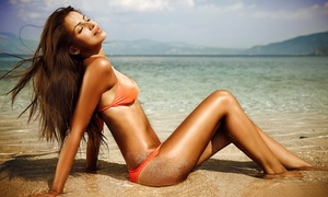 Bella Tan Studio: Two Versaspa or UV-Tanning Sessions or One Organic Airbrush Tan at Bella Tan Studio (59% Off)