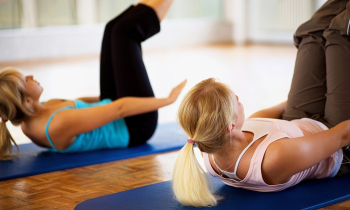 Above & Beyond The Pilates Studio - Lisle: $32 for Four Pilates Classes at Above & Beyond The Pilates Studio ($72 Value)