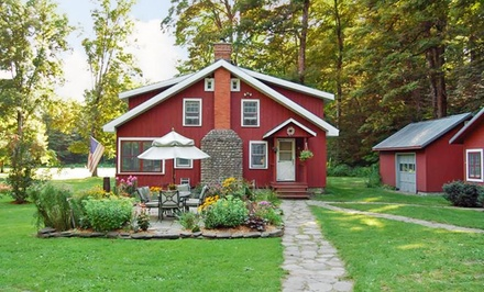 Groupon Deal: 1- or 2-Night Cabin Stay for Up to Four with S'mores and a Bottle of Wine at Wellnesste Lodge in Taberg, NY